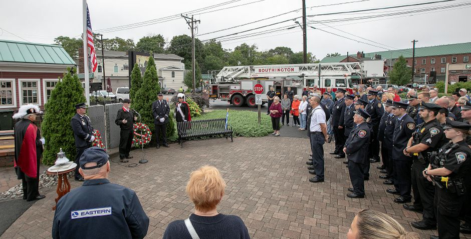 Retired Southington firefighter Roger Mathieu, left, leads the annual 9/11 remembrance ceremony at the 9/11 memorial site along the Farmington Canal Heritage Trail in Southington, Tuesday, Sept. 11, 2018. Dave Zajac, Record-Journal