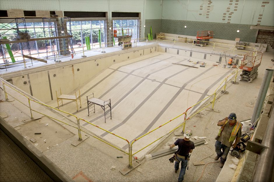 Construction crews continue work in the pool area of Maloney High School, Wednesday, July 29, 2015. The school is in the midst of a $107.5 million reconstruction and renovation project. | Dave Zajac / Record-Journal