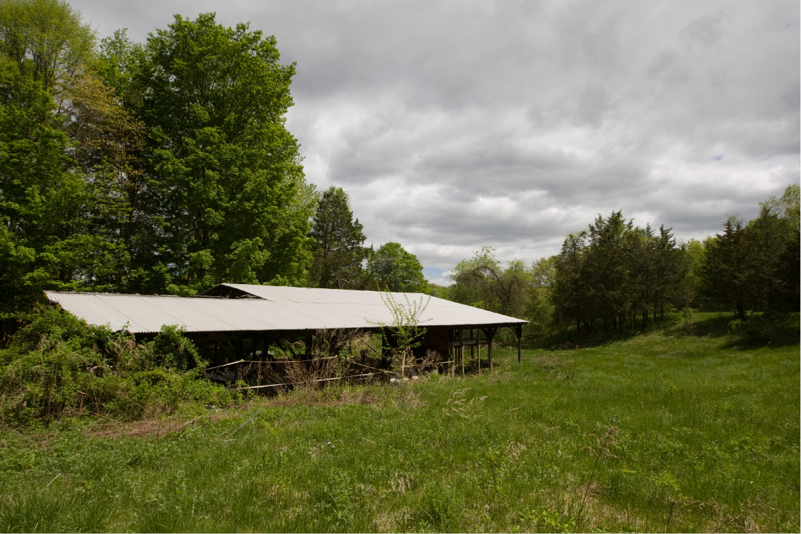 A structure located on a 25-acre property at 947 Cornwall Ave. in Cheshire, Wednesday, May 13, 2015.  Developers have proposed a 21-lot subdivision at the end of Cornwall Ave. on land owned by the family of Fred Bens, a former first selectman, public works director and farmer.  |  Dave Zajac / Record-Journal