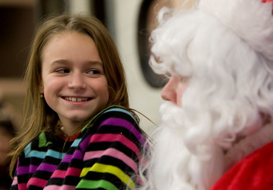 "Emily Garafola, 10, of Southington, visits with Santa at Southington Fire Dept. Engine Company #2 during ""Christmas in the Village"" in Plantsville, Thursday, December 5, 2013. 