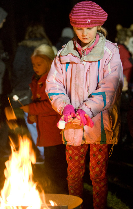 Katie Black, 9, of Madison, roasts a marshmallow during Christmas in the Park at Hubbard Park in Meriden, Tuesday, Dec. 6, 2016. The annual event features horse drawn carriage rides, face painting, balloon animals, musical entertainment, food and refreshments.  | Dave Zajac, Record-Journal
