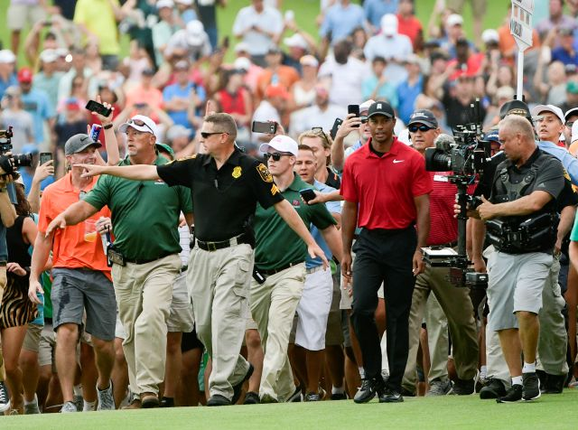 File- This Sept. 23, 2018, file photo shows Tiger Woods making his way down the 18th fairway during the final round of the Tour Championship golf tournament in Atlanta. Woods said Tuesday, Jan. 22, 2019, he doesn