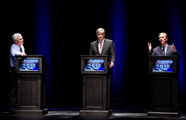 Independent candidate Oz Griebel, left, Republican Party candidate Bob Stefanowski, center, listen as Democratic Party candidate Ned Lamont, right, speaks during a gubernatorial debate at the University of Connecticut in Storrs, Conn., Wednesday, Sept. 26, 2018. (AP Photo/Jessica Hill)