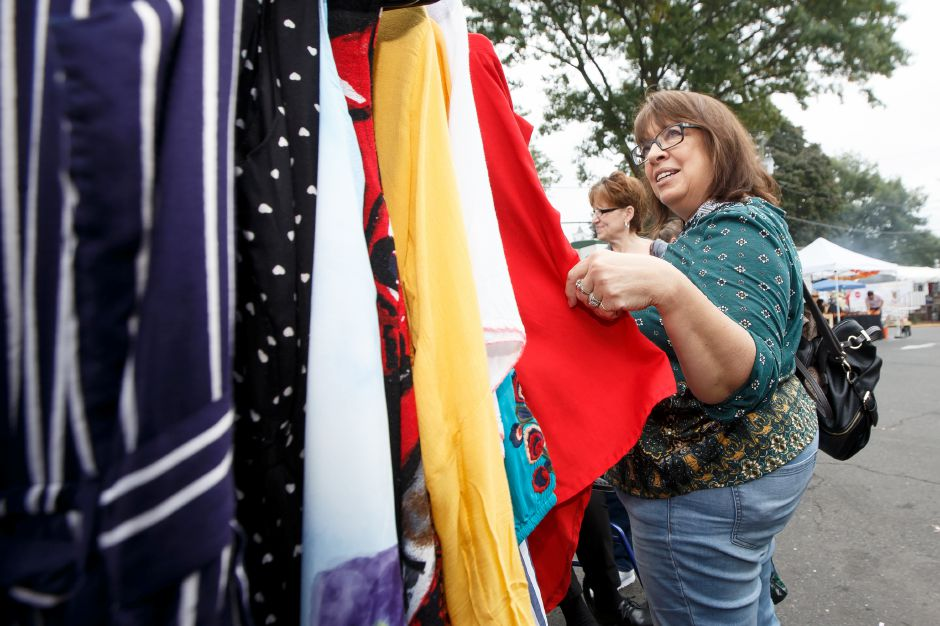 Sharon Konopka of Meriden stops at a clothing vendor Sunday during the Arts and Crafts show at the Apple Harvest Festival in Southington October 7, 2018 | Justin Weekes / Special to the Record-Journal