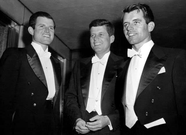 FILE-- Sen. John F. Kennedy, center, D-Mass., and his brothers Edward Kennedy, left, a student at the University of Virginia, and Robert F. Kennedy, chief counsel to the Senate Rackets Committee, attend the annual Gridiron Club dinner in Washington, D.C., on March 15, 1958. The suburban Boston house where Robert F. Kennedy was born, now a national historic site in tribute to his more famous brother, President John F. Kennedy, is holding a special exhibition to mark the 50th anniversary of RFK