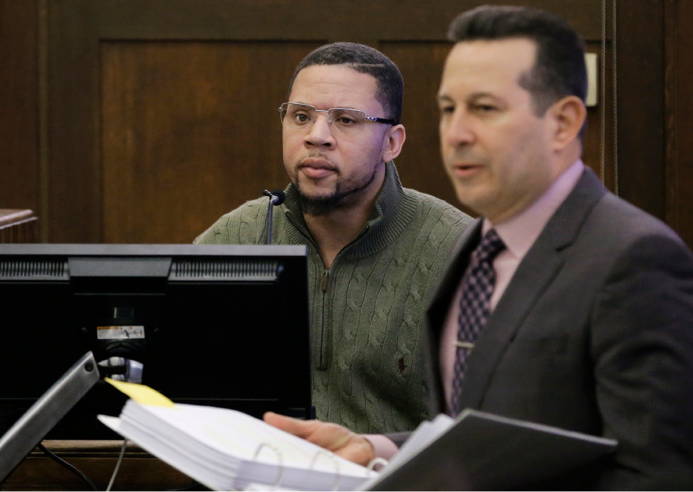 Witness Alexander Bradley, left, is questioned by defense attorney Jose Baez, right, while testifying during the double murder trial for former New England Patriots tight end Aaron Hernandez in Suffolk Superior Court, Thursday, March 23, 2017, in Boston. Hernandez is on trial for the July 2012 killings of Daniel de Abreu and Safiro Furtado who he encountered in a Boston nightclub. The former NFL football player is already serving a life sentence in the 2013 killing of semi-professional football player Odin Lloyd. (AP Photo/Steven Senne, Pool)