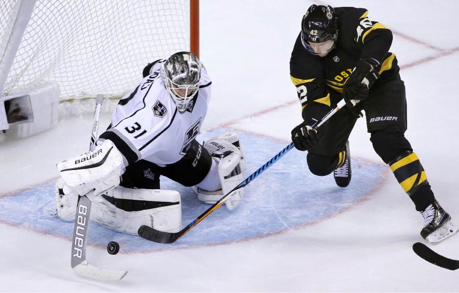 Los Angeles Kings goalie Peter Budaj, left, of Slovakia, defends as Boston Bruins right wing David Backes, right, tries to score in the second period of an NHL hockey game, Sunday, Dec. 18, 2016, in Boston. (AP Photo/Steven Senne)