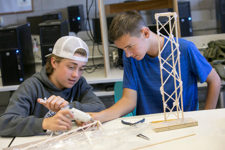 Students, Jake Festa, 16, left, and Ryan Carey, 15, work together on a crane tower project.