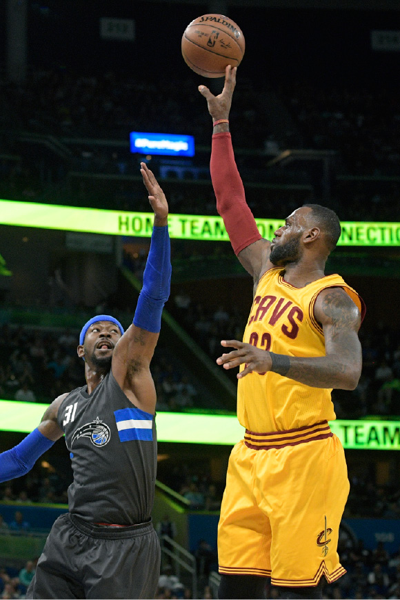 Cleveland Cavaliers forward LeBron James (23) goes up  to shoot in front of Orlando Magic forward Terrence Ross (31) during the first half of an NBA basketball game in Orlando, Fla., Saturday, March 11, 2017. (AP Photo/Phelan M. Ebenhack)