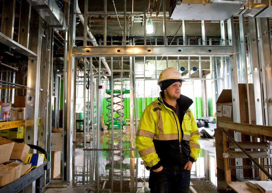 Kyle Richard, field engineer, looks over the northeast section of the mixed-use building under construction at 24 Colony St. in Meriden, Wednesday, February 24, 2016. | Dave Zajac / Record-Journal