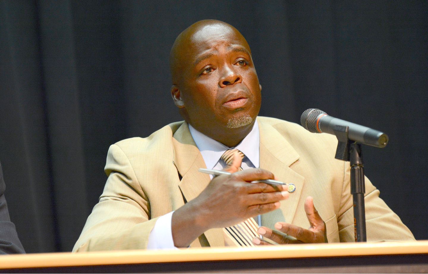 FILE PHOTO -- City Councilor Larue Graham speaks at a public forum on an increase in violence in Meriden on Tuesday, Sept. 20, 2016. | Bryan Lipiner, Record-Journal
