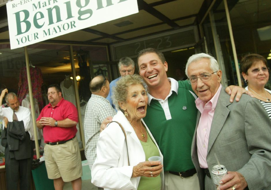 Maggie Decker, left, Mayor Mark Benigni, and Manny Cunha, right, have a laugh with the mayor at a fundraiser at Fischer