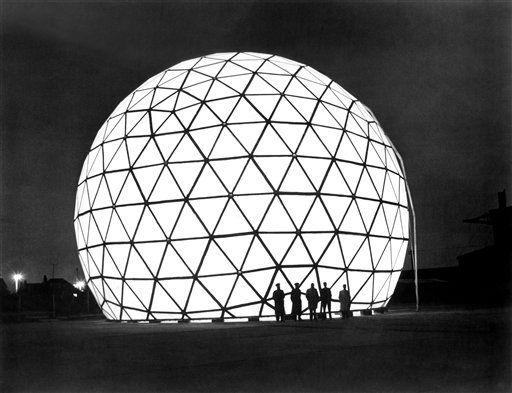 A giant reinforced plastic dome at Freckleton, England on Nov. 14, 1961, looking at night somewhat like an outsize Christmas tree decoration, protects radar equipment. Capable of withstanding high winds and below zero temperatures, it has some 300 prefabricated panels bolted together. Over 50 feet high and 70 feet in diameter, it is believed to be Europe's biggest reinforced plastics structure. The English Electric Co. Ltd., English Electric House, Strand, London, W.C. 2, England. (AP Photo)