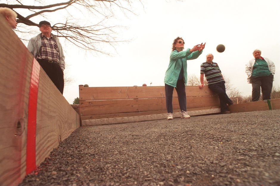 RJ file photo - Margaret Paradis, center, tosses a bocce ball toward the pallino - the target ball - during a game at the Calendar House Senior Center May 1, 1999.