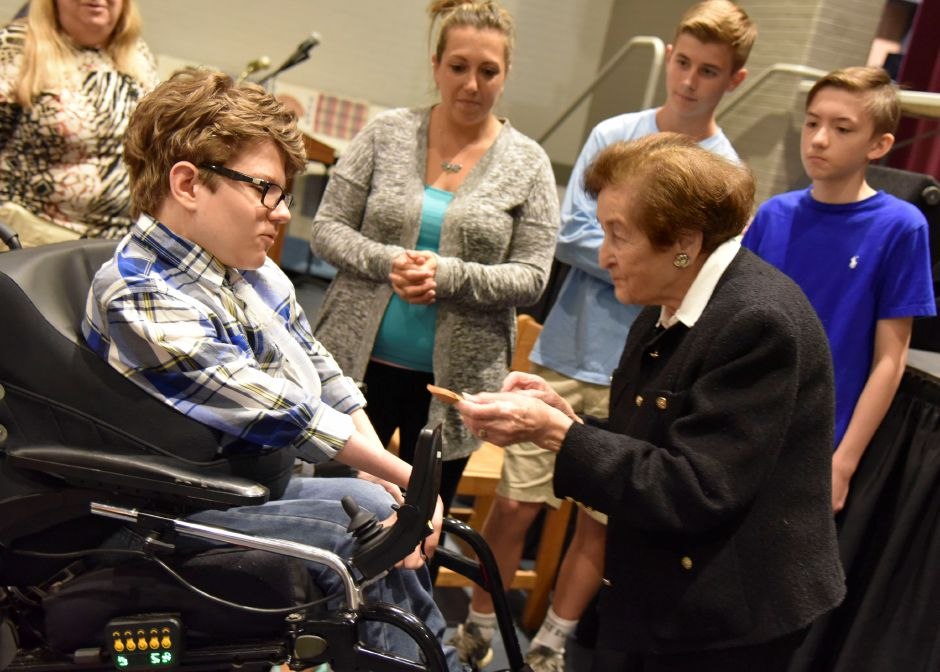 Holocaust survivor Judith Altmann gifts a piece of brick she saved from her time in the concentration camp Auschwitz to North Haven Middle School student Hunter Pageau after speaking to eighth-grade students on May 24, 2019. | Bailey Wright, Record-Journal