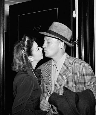 Bing Crosby and his wife Dixie Lee see each other at a New York Hotel on Oct. 21, 1941, after Bing returned from South America on the liner Brazil. (AP Photo)