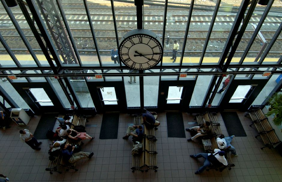 The clock at the South Norwalk train station waiting room is stopped at 4:15 p.m.. Thursday, Aug. 14, 2003, in South Norwalk, Conn. commuters wait for a train, but Metro North is shut down because of a power outage. Electric power outages are shutting down services in the North East, Thursday, . (AP Photo/Douglas Healey).