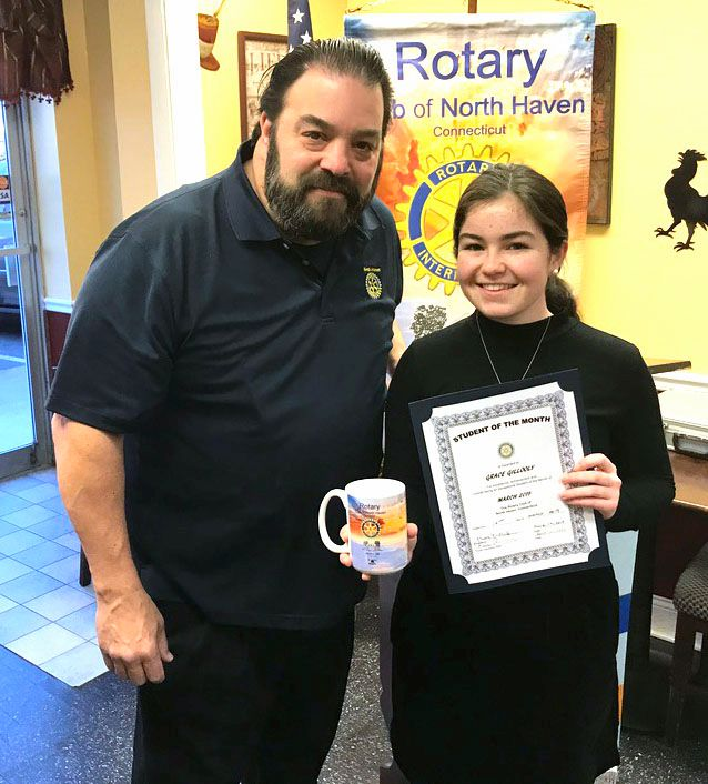 North Haven Rotary President Elect Ronald Bathrick with Student of the Month Grace Gillooly.