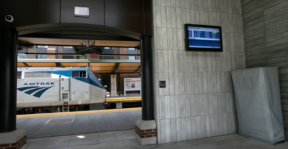 An Amtrak train pulls into the Meriden station, Friday afternoon, March 23, 2018. One of several new ticket vending machines, far right, have been installed at the Meriden, Wallingford, and Hartford CTrail stations in preparation for service to start in May. The machines are currently covered. Dave Zajac, Record-Journal