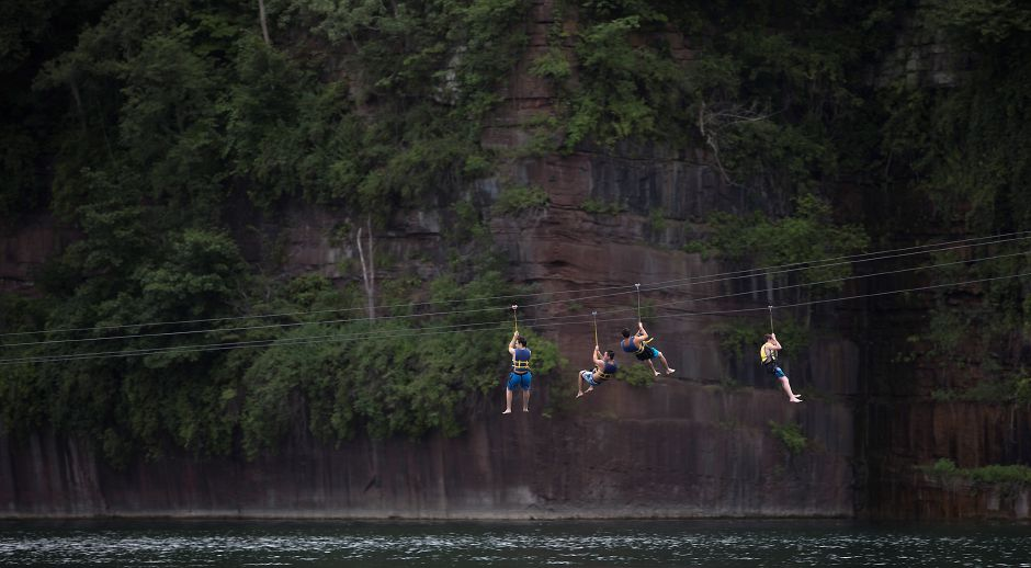 Zipliners glide down from cliffs at Brownstone Exploration & Discovery Park in Portland on July 6. Dave Zajac, Record-Journal
