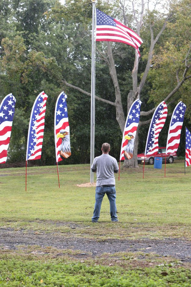 Veterans and guests stand for the raising of the flag during the celebration of the American Legion's 100th anniversary at the annual American Legion Post 45 All American Picnic in Meriden on Saturday, Sept. 14, 2019. Emily J. Tilley, special to the Record-Journal.