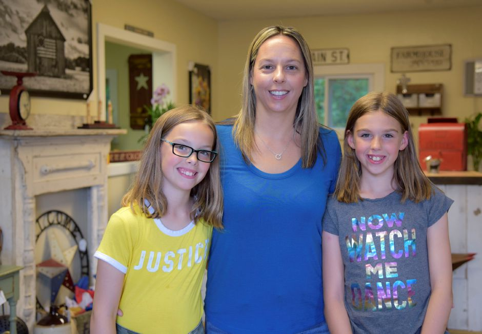 Jessie Christopher with her daughters Olivia, 9, left, and Aubrey, 10, in Christoper's new country-store in Durham, at 354 Main St.