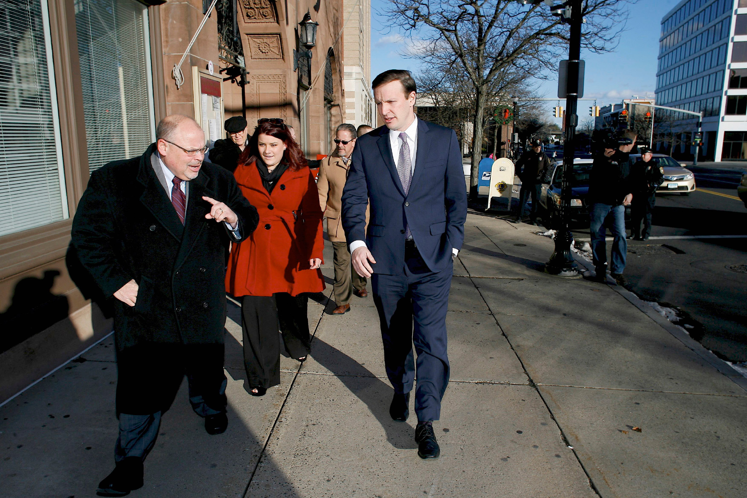 FILE PHOTO --. Sen. Chris Murphy, right, walks with New Britain