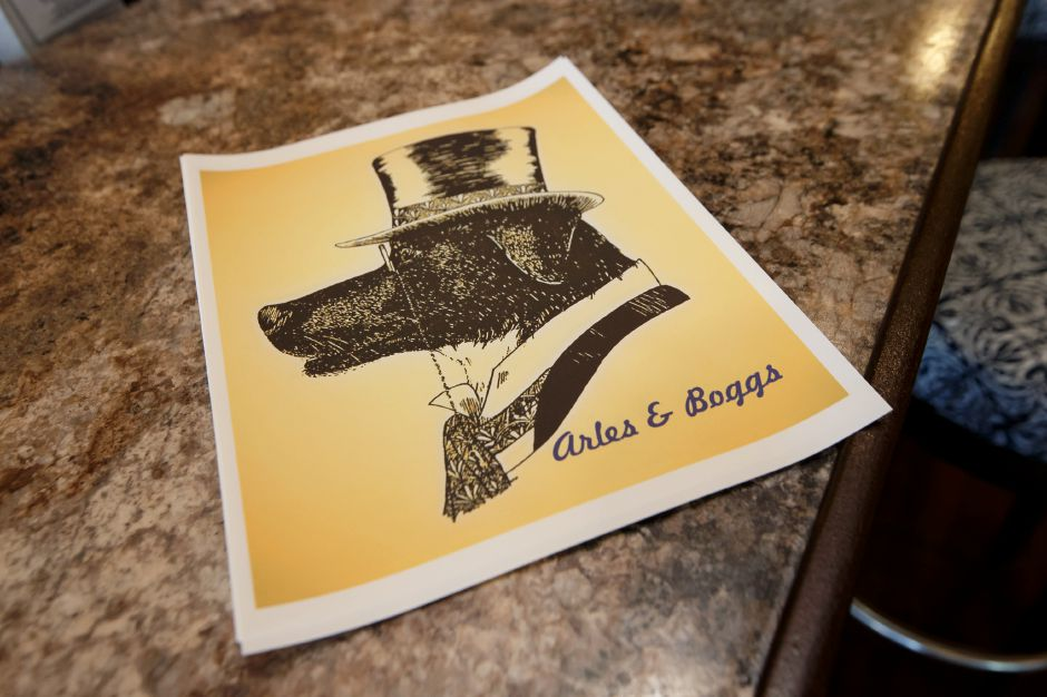 Artist Zoe Brinkley was commissioned to design a logo for the restaurant Wednesday at Arles and Boggs Vegan Eatery in Wallingford October 10, 2018 | Justin Weekes / Special to the Record-Journal