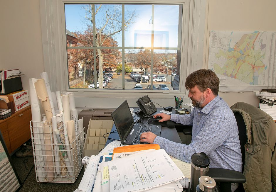 City Planner Bob Seale works at his desk at Meriden City Hall on Thursday. Dave Zajac, Record-Journal