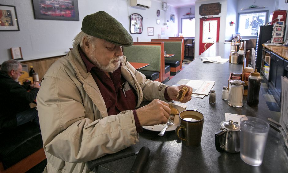 Joe Severino, of Wallingford, enjoys a steak sandwich at Scotty's Breakfast nook on Hall Avenue in Wallingford, Tuesday, March 13, 2018. Dave Zajac, Record-Journal