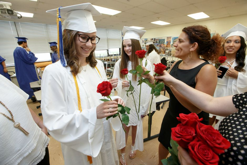 Nicole Cislo receives her rose before walking out to the ceremony Friday during Lyman Hall High School