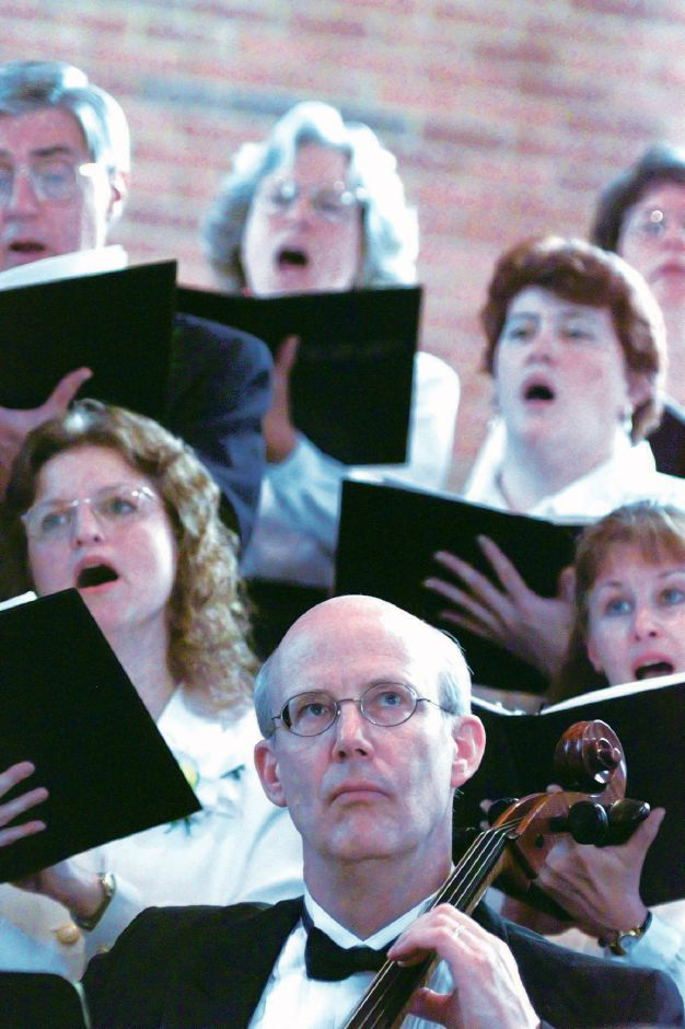 RJ file photo - Cellist James Kirchmyer ( foreground) performs with other members of the Southington Festival Chorale during the annual spring concert at First Lutheran Church on Sunday May 23, 1999.