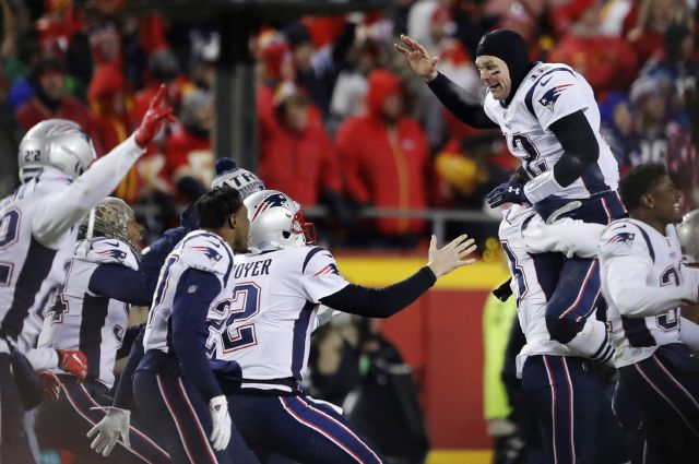 New England Patriots quarterback Tom Brady (12) celebrates with his teammates after the AFC Championship NFL football game, Sunday, Jan. 20, 2019, in Kansas City, Mo. (AP Photo/Charlie Neibergall)