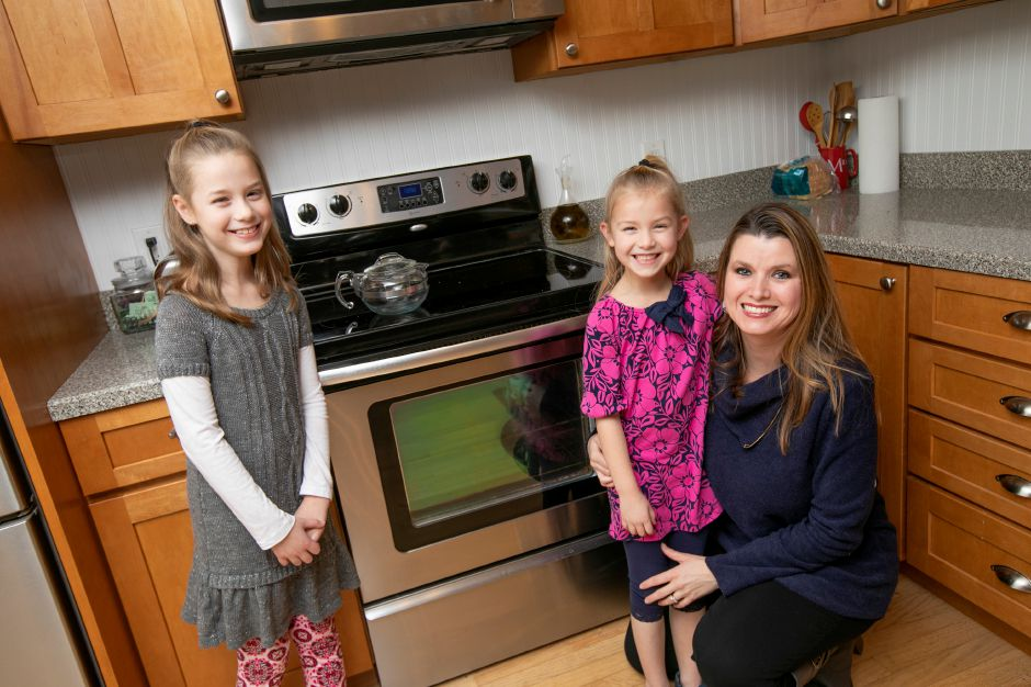 Jill White poses with her children, Audrey, left, and Mia. The family is a finalist in the My Dreamvention contest by Frito-Lay for their idea for an alarm that lets parents know when children are too close to a hot stove. Dave Zajac, Record-Journal