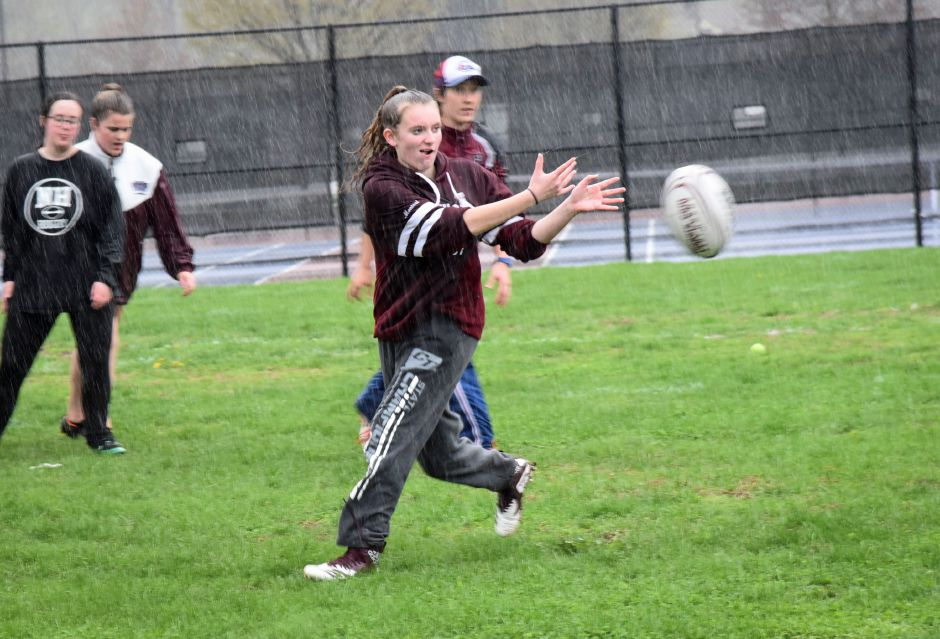 North Haven high school students practice rugby in the rain, at the athletic complex on April 22, 2019. Their next game is May 2, 4:30 p.m. at the athletic complex. | Bailey Wright, North Haven Citizen