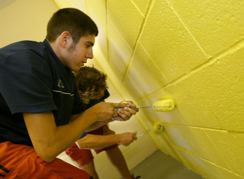 Pool maintenance workers Joe Gigante age 19 (foreground) and Pat Phelan age 18 (background) paint the Wallingford Community Pool shower rooms as they get ready for Sunday June, 27, 2004 opening date.