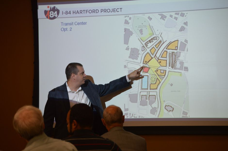 File photo: William Kenworthy, principal with design firm HOK, discusses one option for a new transit center in Hartford, just one aspect of a larger plan to redesign Interstate 84 through the capital city. Current plans for the project would bring I-84 down to ground level, which would also require the relocation of the rail line. The project