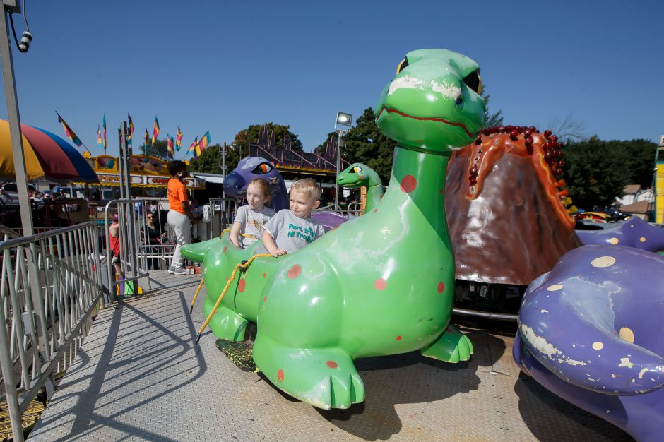 Liam Cook 3 and sister Chloe 6 of Southington take a ride in the midway Saturday during the Southington Apple Harvest Festival in Southington September 29, 2018 | Justin Weekes / Special to the Record-Journal