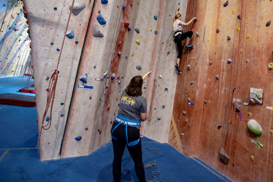 Record-Journal Digital Content Producer Ashley Kus gives climbing a try at Prime Climb in Wallingford as manager Kristina Godfrey spots her Aug. 20, 2018. | Richie Rathsack, Record-Journal