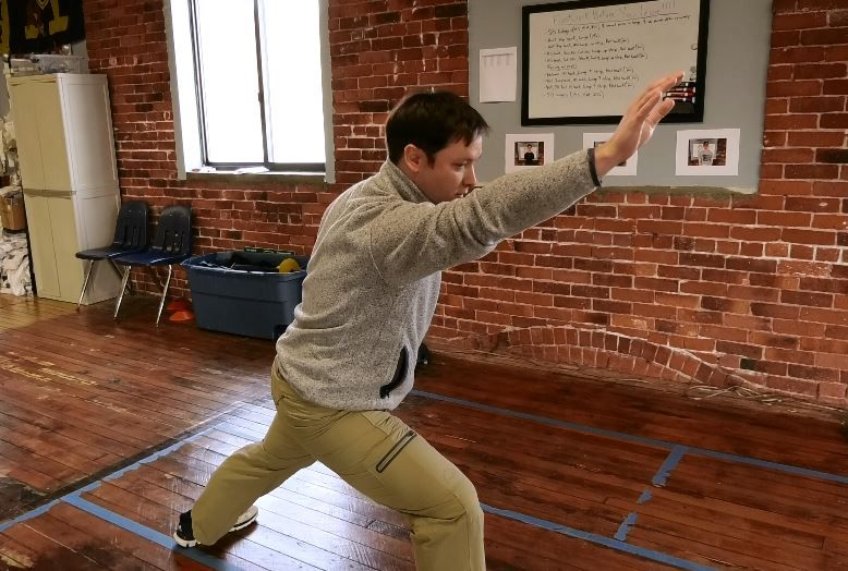 Kyle Mezzi, owner and coach, demonstrates a lunge used during fencing practice and competitions at Silver City Fencing Club, 340 Quinnipiac St., Wallingford. |Ashley Kus, Record-Journal