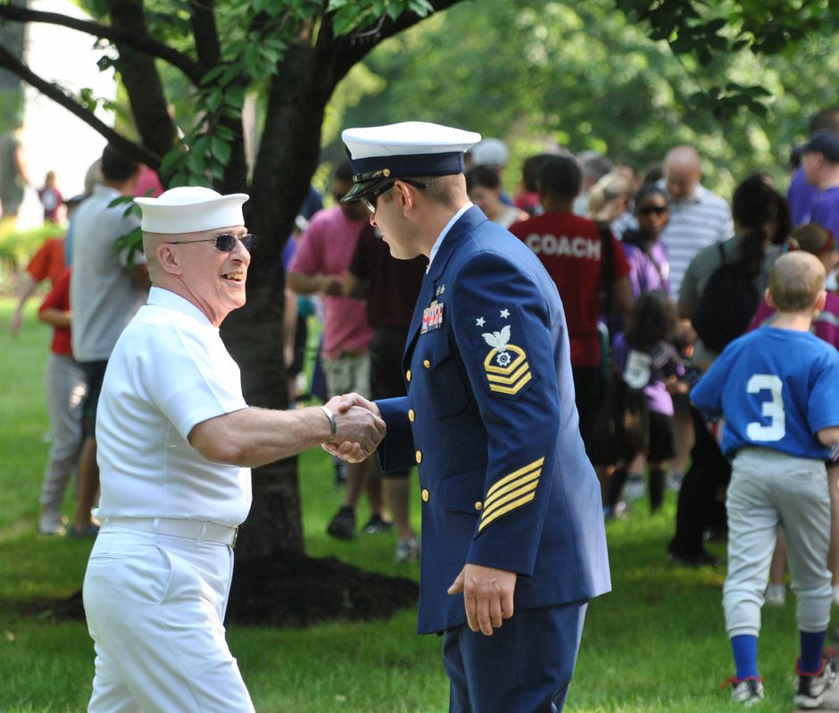 From left: Navy Veteran and Color Guard Commander Bruce Gallup greets Master Chief Deans of the U.S. Coast Guard with a hand shake before the start of the Memorial Day parade in downtown Wallingford, May 28, 2012. (Tyler Salomon/Record-Journal)