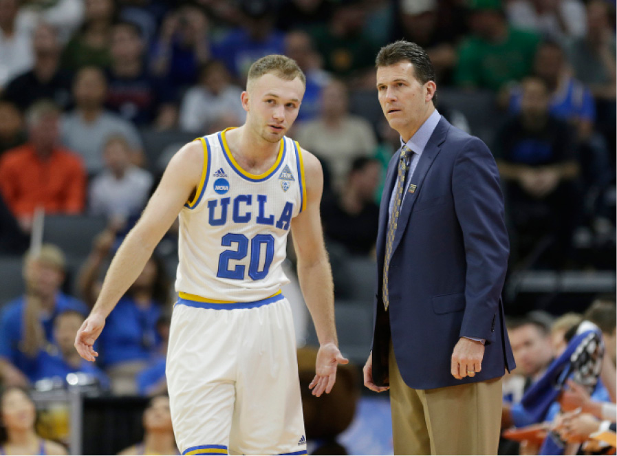 UCLA coach Steve Alford talks with his son, guard Bryce Alford, during the first half of Friday's first-round game against Kent State in Sacramento, Calif. | Associated Press