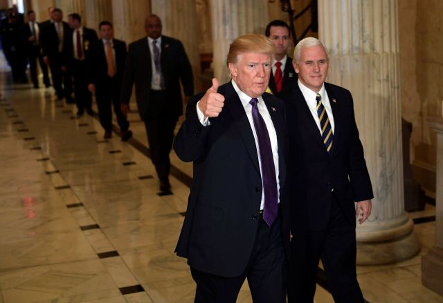 President Donald Trump gives a thumbs up as he walks with Vice President Mike Pence as he departs Capitol Hill in Washington, Thursday, Nov. 16, 2017. Trump urged House Republicans Thursday to approve a near 1.5 trillion tax overhaul as the party prepared to drive the measure through the House. Across the Capitol, Democrats pointed to new numbers showing the Senate version of the plan would boost taxes on lower and middle-income Americans.  (AP Photo/Susan Walsh)