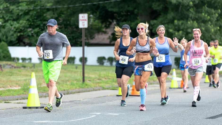 Suzette Reading runs down Locust Street during the Chips Family Restaurant Road Race on July 21, 2019. The run started on East Street in front of Plainville High School and ended on Robert Holcomb Way. | Devin Leith-Yessian/Plainville Citizen
