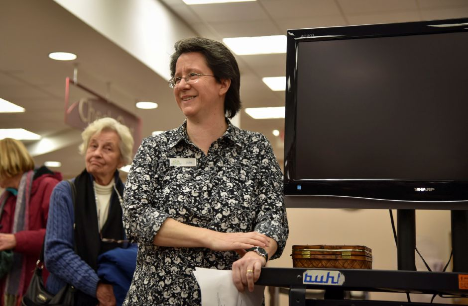 Wallingford Public Library Adult Programming and Community Services Librarian Julie Rio, at the One Book One Wallingford Book reveal party at the library on Wednesday, Jan. 10, 2018. | Bailey Wright, Record-Journal