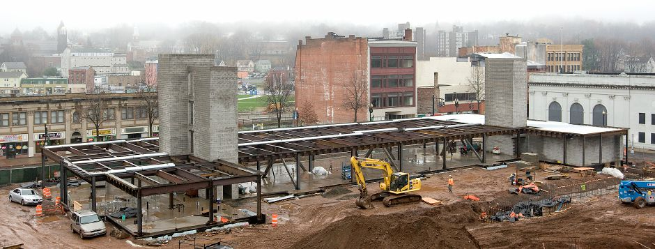 Work crews continue construction on a new parking garage and mixed-use building at 24 Colony St. in Meriden, Wednesday, Dec. 2, 2015. The project is expected to be completed by November 2016. | Dave Zajac / Record-Journal
