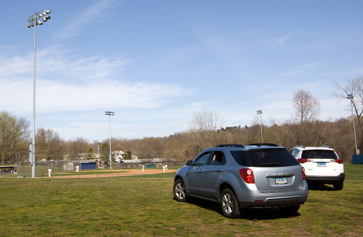 Spectator cars parked on the south side of Pat Wall field in Wallingford, Monday, April 18, 2016. The Planning and Zoning Commission approved a plan to expand the parking area at Pat Wall Field.   |  Dave Zajac / Record-Journal
