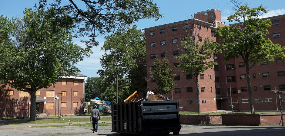 A man walks through the Mills Memorial Apartments in Meriden, Monday, July 3, 2017. | Dave Zajac, Record-Journal