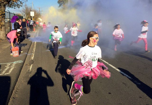 In this Nov. 5, 2016 photo, children participate in the fun run at the annual Vicki Soto 5K race in Stratford, Conn. The race is held by the Soto family to raise money to fund scholarships for students interested in careers in education. First-grade teacher Vicki Soto was one of 26 people killed during a shooting inside the Sandy Hook Elementary School on Dec. 14, 2012, in Newton, Conn. (AP Photo/Pat Eaton-Robb)