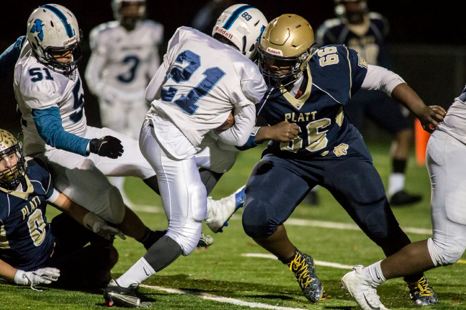 Platt defensive tackle Jaylen John stops Middletown running back Tyreece Lumpkin at Falcon Field on Nov. 8. Only a junior, John has been a two-way force on the Platt line and has caught the attention of college coaches. Photos by Justin Weekes, special to the Record-Journal
